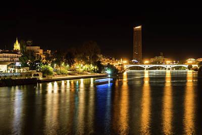 Photograph - Seville Night Magic - Triana Bridge And The One And Only Skyscraper by Georgia Mizuleva