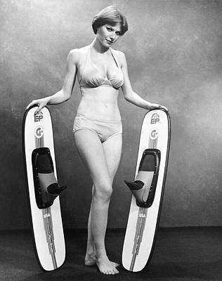 Sexy Woman Advertises Skis Art Print by Underwood Archives