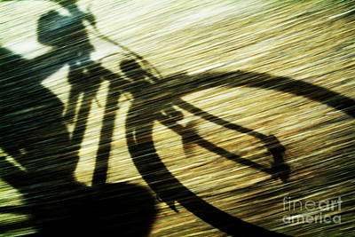 Shadow Of A Person Riding A Bicycle Print by Sami Sarkis