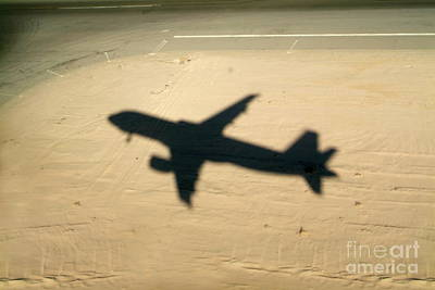 Shadow Of Airplane Flying Into Land Art Print by Sami Sarkis