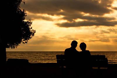 Sharing A Sunset Art Print by Carl Jackson