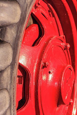 Photograph - Shiny Red Tractor Wheel by Joni Eskridge