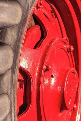 Photograph - Shiny Red Tractor Wheel by Joni Eskridge