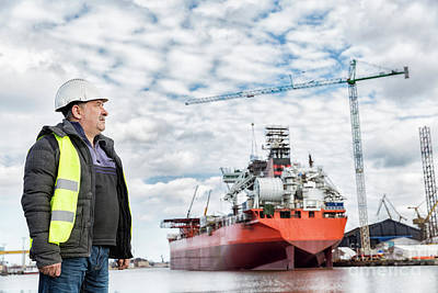 Photograph - Shipbuilding Engineer At The Dockside In A Port. by Michal Bednarek