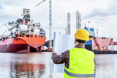 Collar Photograph - Shipbuilding Engineer Checking Documents At The Dock Side In A Port. by Michal Bednarek