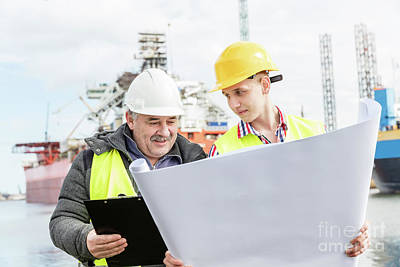 Photograph - Shipbuilding Engineer Explains Technical Matters With A Student Worker. by Michal Bednarek