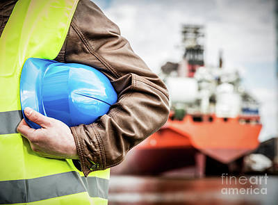 Photograph - Shipbuilding Engineer With Safety Helmet In Shipyard by Michal Bednarek