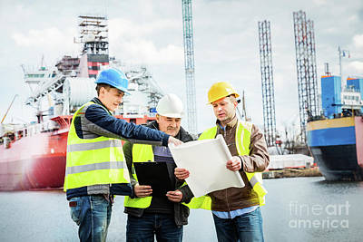 Photograph - Shipbuilding Engineers Introducing New Solution In A Shipyard by Michal Bednarek