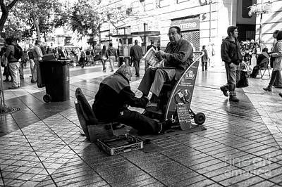 Photograph - Shoeshine In Santiago Chile by John Rizzuto