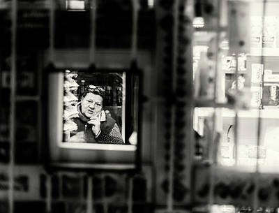 Photograph - Shopkeeper At Night by John Williams
