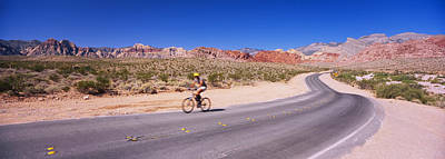 The Red Road Photograph - Side Profile Of A Person Cycling by Panoramic Images