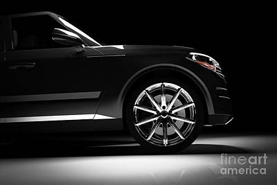 Photograph - Side View Of Modern Black Suv Car In A Spotlight by Michal Bednarek