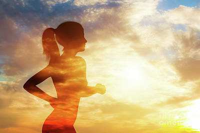 Photograph - Silhouette Of A Running Woman On Sky Background. by Michal Bednarek