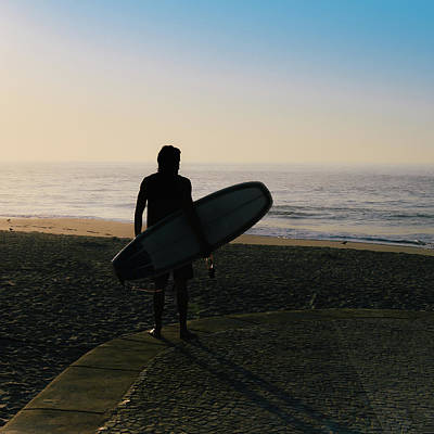 Photograph - Silhouette Of A Surfer With A Surfboard by Alexandre Rotenberg