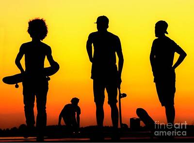 Photograph - Silhouette Of Skateboarders At Sunset by Alexandre Rotenberg