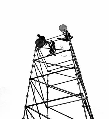 Photograph - Silhouette Of Workers Setting Up Lights by Yali Shi
