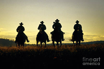 Silhouetted Cowboys Art Print by Inga Spence