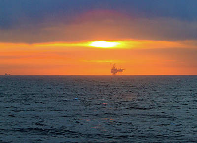 Photograph - Silhouetted Oil Drilling Platform  by Allan Levin