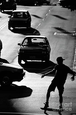 Photograph - Silhouetted Skateboarder Along The Ave by Jim Corwin