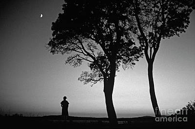 Photograph - Silhouetted Woman Sunset With Crescent Moon by Jim Corwin
