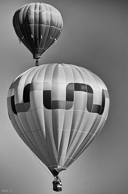 Photograph - Silver Sky Balloons by Kevin Munro