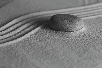 Photograph - Single Meditation Stone On Flowing Sand Number 1 Black And White by Andrew Pacheco