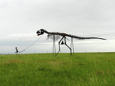 Photograph - Skeletal Man Walking His Dinosaur Statue by Breck Bartholomew