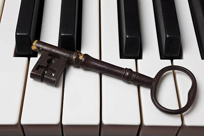 Piano Keys Photograph - Skeleton Key On Piano Keys by Garry Gay