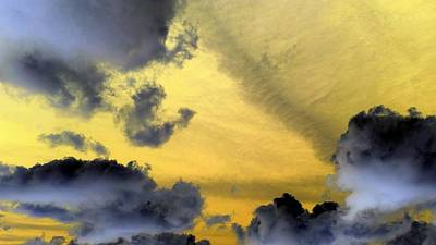 Photograph - Dark Puffy Clouds by Richard Yates
