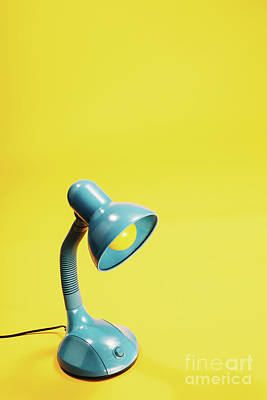 Photograph - Sky-blue Desk Lamp On Yellow Background. by Michal Bednarek