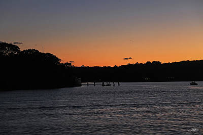 Photograph - Sky Glowing In Orange Over River by Mike M Burke