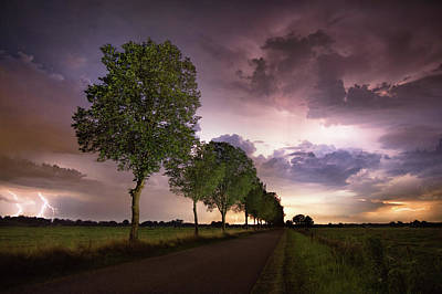 Lightning Photograph - Trees And Lightning by Martin Podt
