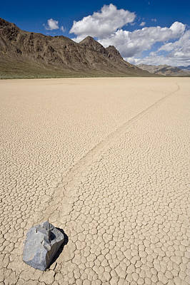 Motion Photograph - sliding rock on the Racetrack Playa Death Valley by Ed Book