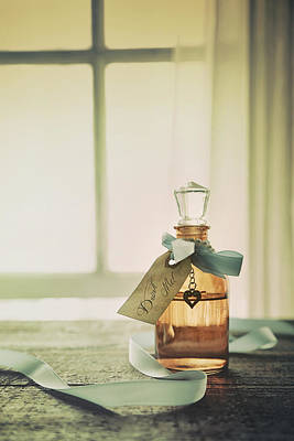 Photograph - Small Bottle With Ribbon And Tag by Sandra Cunningham