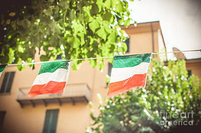 Waving Flag Photograph - small Italian flags hanging by a thread by Luca Lorenzelli