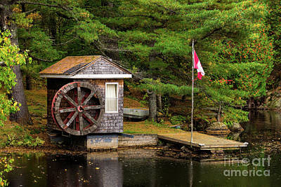 Photograph - Small Shed With A Large Wooden Wheel by Les Palenik
