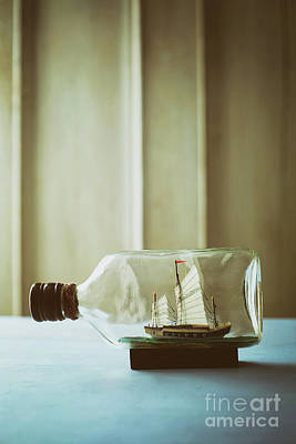 Photograph - Small Ship In A Bottle On Table by Sandra Cunningham
