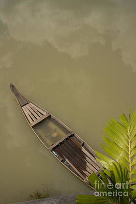 Photograph - Small Wooden Boat In Muddy Lake In Asia With Cloud Reflection by Jason Rosette