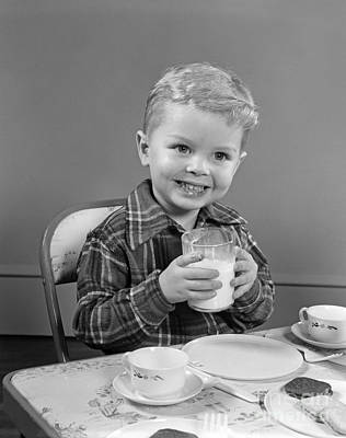 Smiling Boy With Glass Of Milk, C.1950s Art Print by H. Armstrong Roberts/ClassicStock