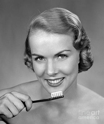 Photograph - Smiling Woman Holding Tooth Brush by H Armstrong Roberts ClassicStock