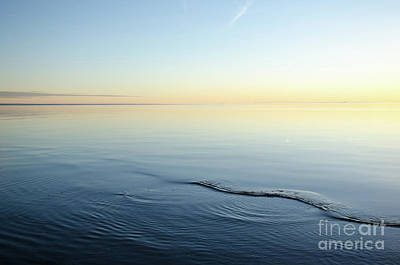 Photograph - Smooth Water And Colorful Sky by Kennerth and Birgitta Kullman