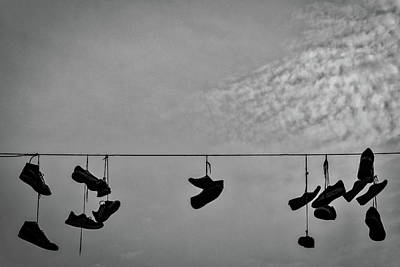 Photograph - Sneakers On A Wire by Stuart Litoff