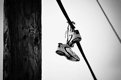 Telephone Poles Photograph - Sneakers On Power Line by Bill Cannon