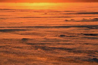 Photograph - Snow Blowing Across The Ice At Sunset by Lyle Crump