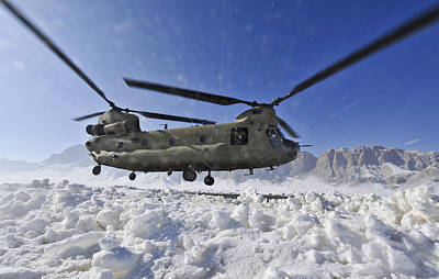 Snow Flies Up As A U.s. Army Ch-47 Print by Stocktrek Images
