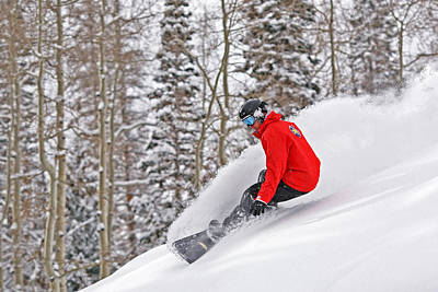 Photograph - Snowboarder Enjoying Deep Fresh Powder At Brighton Ski Resort. by Paul Kennedy
