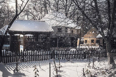 Photograph - Snowfall Over Old Traditional Houses In A Romanian Village by Daniela Constantinescu