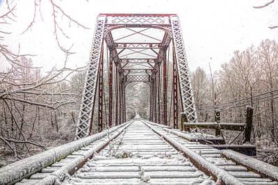 Photograph - Snowy Railroad Trestle In Warm Sepia Tones by Debra and Dave Vanderlaan
