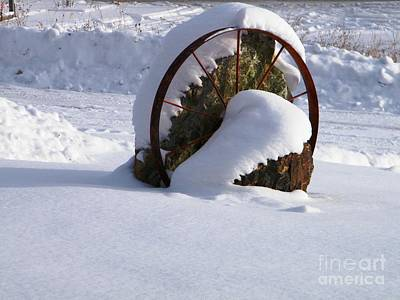 Photograph - Snowy Wagon Wheel by Ann E Robson