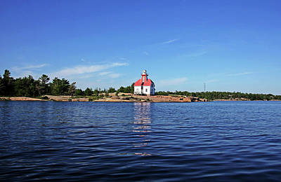 Photograph - Snug Harbour Lighthouse by Debbie Oppermann